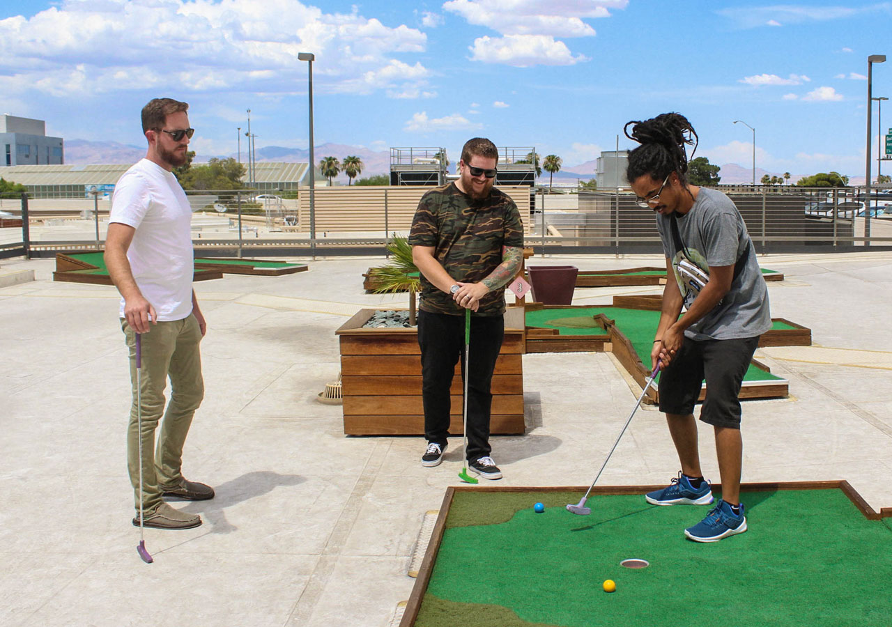 colleagues playing mini golf